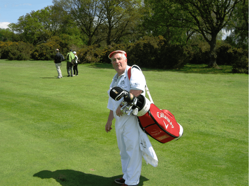 Roger Chequer On Caddy Duties For Steve King at The Trilby Tour At Frilford Heath